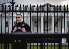 Secret Service Agent Guards the White House Royalty Free Stock Image