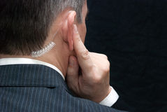 Secret Service Agent Listens To Earpiece, Shoulder Stock Images