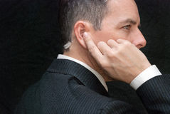Secret Service Agent Listens To Earpiece, Side Royalty Free Stock Photography