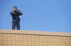 Secret Service agent on rooftop. Security duty during Clinton/Gore 1992 campaign stock photos