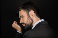 Secret service agent in suit using earphone Stock Photo