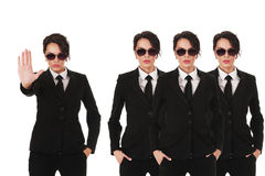 Secret service agents. Group of young secret service agents or police officers isolated over white background stock photo