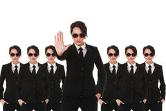Secret service agents. Group of young secret service agents or police officers isolated over white background stock photography