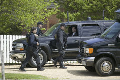 Secret Service agents. And black government SUV's in Williamsburg Virginia on May 4, 2007 in anticipation of the arrival of Her Majesty Queen Elizabeth II and stock photo