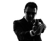 Secret service security bodyguard agent man silhouette. One secret service security bodyguard agent man in silhouette on white background stock images
