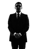 Secret service security bodyguard agent man silhouette. One secret service security bodyguard agent  man in silhouette  on white background Stock Photography