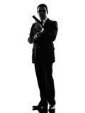 Secret service security bodyguard agent man silhouette. One secret service security bodyguard agent man in silhouette on white background stock photos
