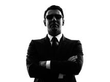Secret service security bodyguard agent man silhou. One secret service security bodyguard agent man in silhouette on white background stock images
