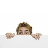 Secret Spy Hiding Behind Sign Royalty Free Stock Photography