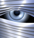 Secret, spying eye behind metal venetian blinds Stock Images