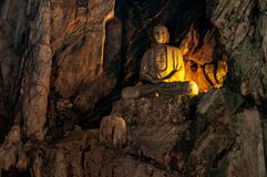 Buddha Statue at secret underground cave temple in Marble Mountains, Da Nang, Vietnam royalty free stock images
