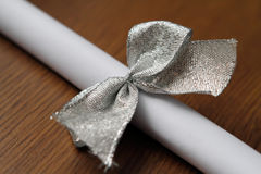 Secret to Silver Ribbon. Closeup view of silver beads, ribbon and paper Stock Photo