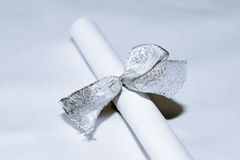 Secret to Silver Ribbon. Closeup view of silver beads, ribbon and paper Stock Photos