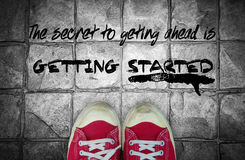 The secret togetting ahead is getting start : Quotation Stock Image