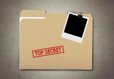 A manila folder with the faded words Top Secret on. Secret top folder red background object copy royalty free stock photography
