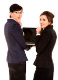 Secret, two young business women with laptop Royalty Free Stock Photography