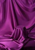 Secret veiled. Something secret veiled under satin silky cloth fabric royalty free stock images