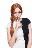 Secret, woman with finger on lips isolated. Keeping secret. Young beautiful woman with finger on lips, hush sign. Adultery, cheating, sexual secret concept Stock Images