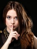 Secret woman. Girl showing hand silence sign Stock Photos