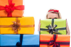 Secret woman hiding behind presents Stock Photos