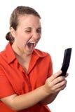 Secretaresse die bij haar cellphone schreeuwt Royalty-vrije Stock Afbeeldingen