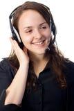 Secretaresse met een hoofdtelefoon Royalty-vrije Stock Afbeelding