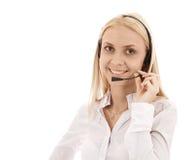 Secretaresse mooi meisje in hoofdtelefoons met een microfoon, smilin Royalty-vrije Stock Foto