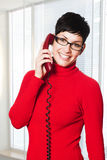 Secretaria en rojo Imagenes de archivo