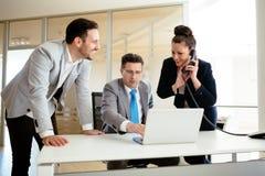 Secretaries assisting boss at business Stock Photos