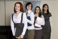 Secretaries standing in line for report Royalty Free Stock Photography