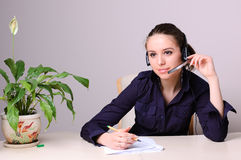 Secretary. Young beautiful girl working as a secretary in the office Royalty Free Stock Photos