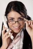 Secretary. Young secretary talking om the phone Stock Images
