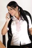 Secretary. Young secretary talking on the phone Royalty Free Stock Photography