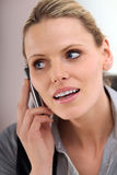 Secretary. Beautiful blond secretary on the phone royalty free stock image