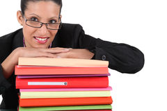 Secretary. Posing with a stack of files Royalty Free Stock Photography