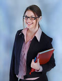 Secretary. Pretty secretary held red book Royalty Free Stock Photography