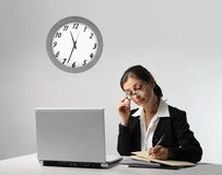 Secretary. In the office late in the night Royalty Free Stock Image