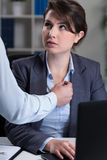 Secretary being intimidated by chief. Portrait of secretary being intimidated by chief Stock Photo