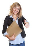 Secretary with blue blazer and file showing thumb up Royalty Free Stock Image