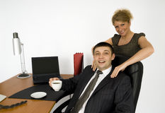 Secretary and boss. Secretary makes massage for her boss Stock Photos