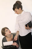 Secretary and boss discussing Stock Photography