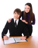 Secretary and the boss is writing documents Stock Photography
