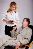 Secretary brings coffee for boss. Royalty Free Stock Images