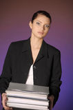 Secretary or business woman with folders of papers Stock Photo
