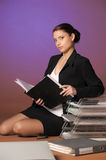 Secretary or business woman with folders of papers Royalty Free Stock Image