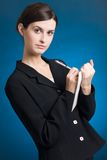 Secretary or businesswoman. Young secretary or businesswoman in suit Royalty Free Stock Image