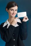 Secretary or businesswoman with blank note card, smiling. Young secretary or businesswoman with blank note card, smiling Stock Photos