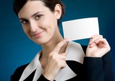 Secretary or businesswoman with blank note card, smiling. Young secretary or businesswoman with blank note card, smiling Stock Images