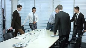Secretary comes in a meeting room. stock footage