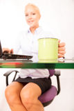 Secretary with a cup of coffee Royalty Free Stock Photography